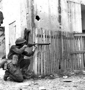 Canadian rifleman in Ortona. PAC Photo.